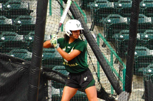 Freshmen Mia Fung works on her swing during practice at the USF softball field on Monday.