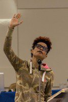 Staceyann Chin recites a poem to delegates at the Consent Culture Forum in Ottawa.