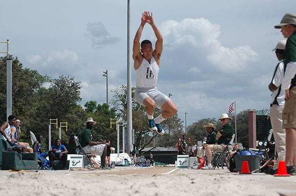 Vinh Le of Long Island University Brooklyn completes a triple jump attempt at the University of South Florida Invitational this past Friday.