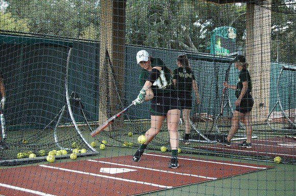 USF freshman Morgan Gross swings at a pitch during batting practice Monday March 9, 2015