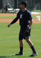 Ross Kivett works on his long toss before practice at TigerTown Friday morning in Lakeland, Fla.