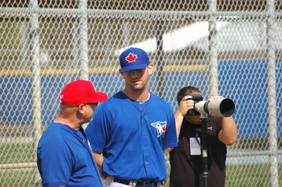 Blue Jays minor league pitcher Scott Silverstein takes advice during spring training on Friday