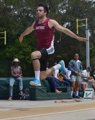Kronstat flies through the air during his first triple jump attempt at the USF Invitational on Friday (photo credit Mitch Sanderson).