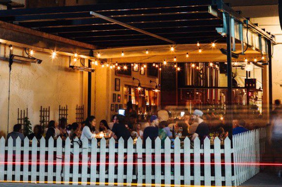 Torontonians enjoy patio season at Bellwoods Brewery, on Ossington Avenue.