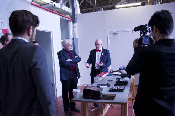 Graham Lewis, right, shows MP Mike Sullivan, left, a typical VHS dismantling workshop.