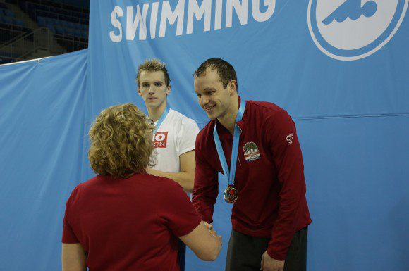 Kier Maitland receives his gold medal after winning the Men's 800 metre freestyle at the Canada Swimming Trials