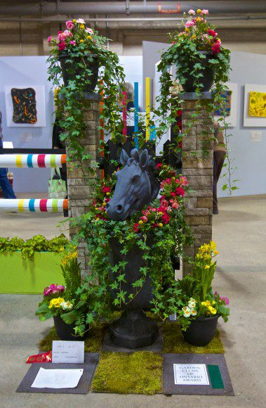 """The exhibit piece, """"Horsepower"""", that Joanna Blanchard and her team at Leaside Garden Society created at Canada Blooms. The piece was awarded first place in the Open Design category."""