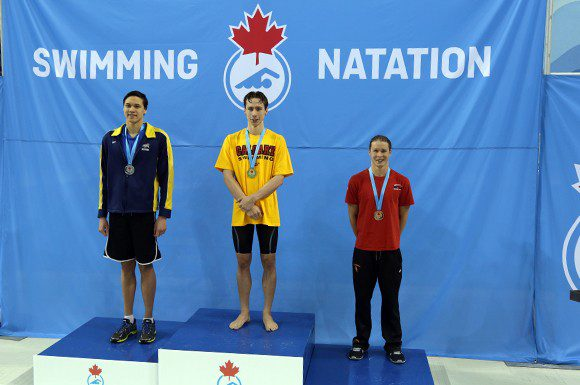 Russell Wood stood on the podium for gold following a personal best at the 2015 Canadian Swimming Trials.