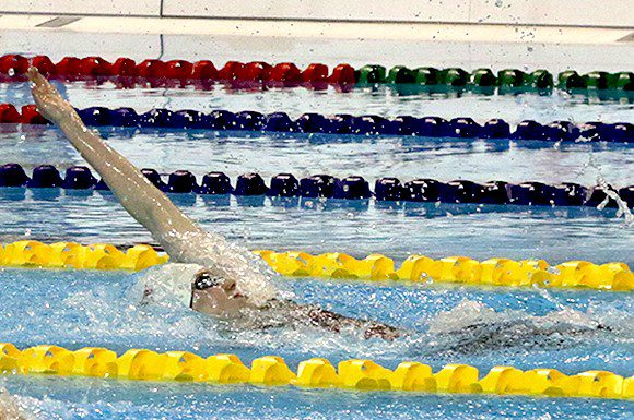 Dominique Bouchard powers home to win the gold medal in 200m backstroke at the National trials on Friday.
