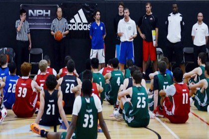 Imad Qahwash, camp director and founder of the Tri Cities Top 40 Camp, addresses his players last summer.