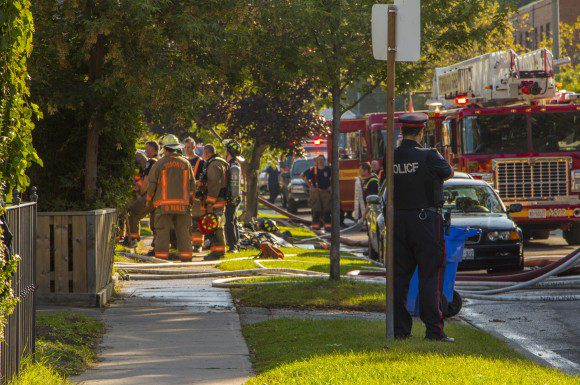 Fire officials and Toronto Police on scene at an early morning house fire on Torrens Avenue in East York on Sept. 15.
