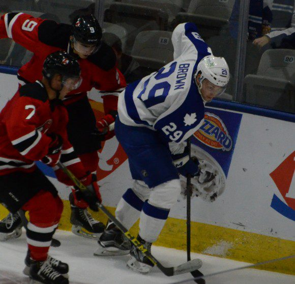 Toronto Marlies forward Connor Brown fighting for the puck during overtime against the visiting Albany Devils.