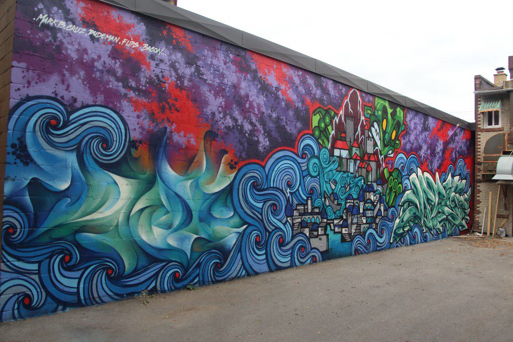 The mural instilled on Friday beside the Canadian Greek Senior Club is a collaboration between StreetARToronto, Toronto Police 54 Division and local street artists.