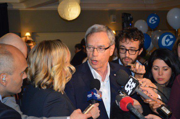 Joe Oliver addresses media after losing Eglinton-Lawrence.