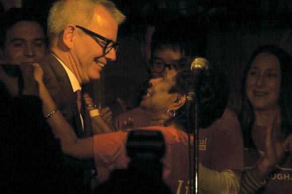 Newly elected MP for Spadina–Fort York, Adam Vaughan, right, receives congratulations at his victory party.