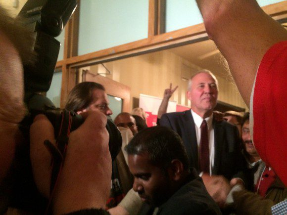 Blair enters his campaign party at Qssis Banquet Hall at Markham and Kingston Roads.