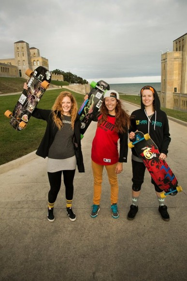Longboarder Candy Dungan and fellow racegoers show their enthusiasm at the 4th Annual Toronto Girls Longboarding race.