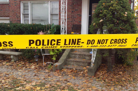 Police tape marks house on Rykert Cres. where gunshot victim was found.