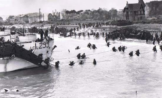 Canadian highland regiments come ashore on Juno Beach late in morning of June 6, 1944.