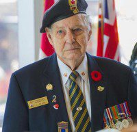 Canadian veteran Allan Dick taking in Remembrance observance at Centennial College, Nov. 11, 2014.