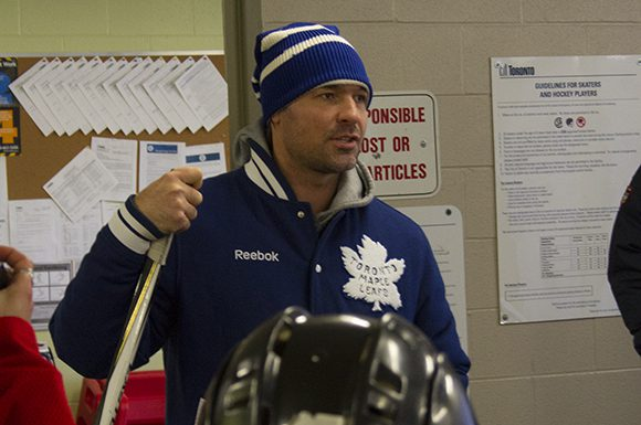 Darcy Tucker delivers a locker room pep talk to the kids before they head out for a clinic on Dieppe Park's outdoor rink.