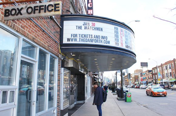 A Passerby looks at show times and prices in front of The Danforth Music Hall