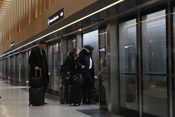 With their luggage in tow, travellers board the UPX train at the Union Station stop in the SkyWalk, a few minutes walk from Union Subway Station, on Feb. 25. The transit line has two other stops at Bloor and Weston stations before arriving at Toronto Pearson International Airport.