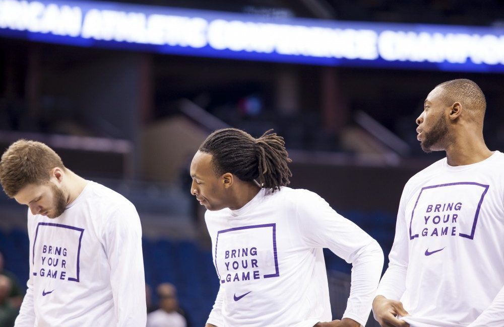 East Carolina's Michael Zangari (left), Kentrell Barkley (centre) and Kanu Aja (right) warm-up before 71-66 loss to South Florida in the first round of the AAC championship on Thursday at the Amway Centre in Orlando, Fla.