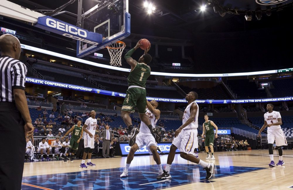 Forward Chris Perry lays the ball in to help the Bulls defeat the Pirates 71-66 at the Amway Center Thursday afternoon.