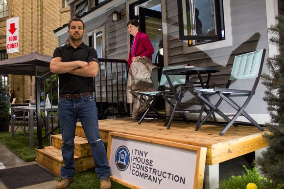 Vic Matthews, owner of Tiny House Construction Company (with Faye Bourgeois in the background).