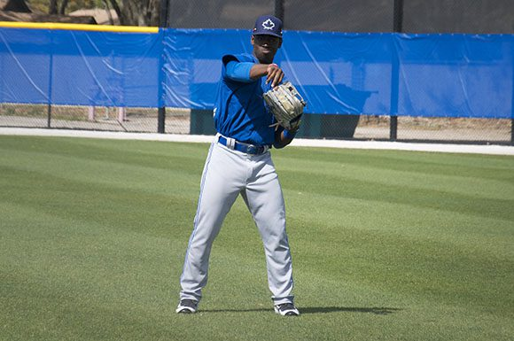 Toronto Blue Jays outfield prospect JD Davis played catch with a teammate before work outs at spring training.