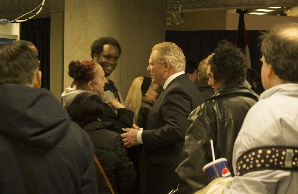 Doug Ford greets supporters at visitation for the late Rob Ford.