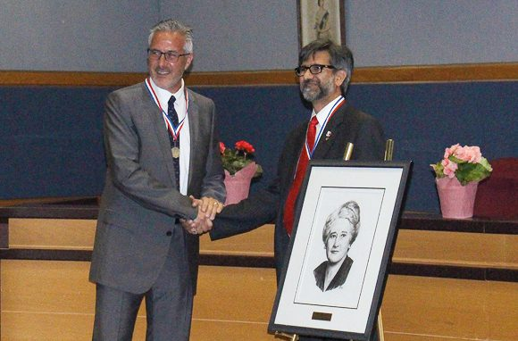 Mohammed Masood Alam, winner of last year's award, presents Patrick Rocca with the 2016 Agnes Macphail award.