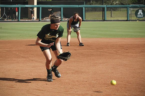 Lauren Evans readies to catch a ball coming her way during a USF Softball practice on March 8. Evans has produced a .304 batting average for her team this season.