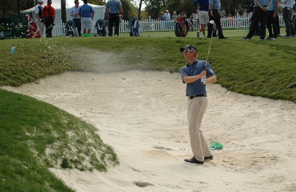 David Hearn working on getting out of the bunker during a practice round of the Valspar Championship on Tuesday