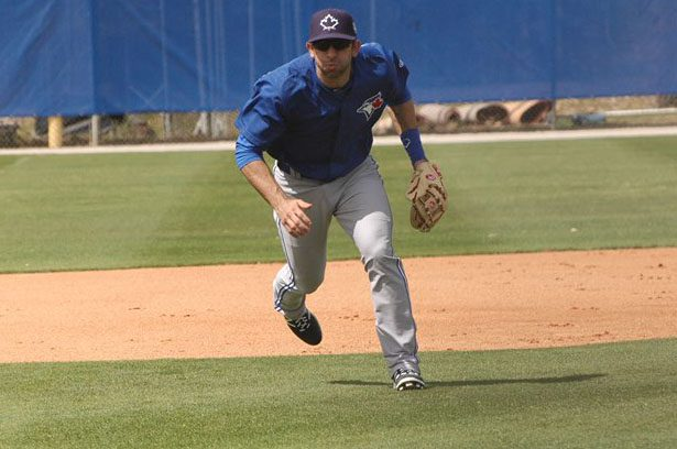 Blue Jays infield prospect Jason Leblebijian charges for a ball during spring-training practice in Dunedin, Fla.