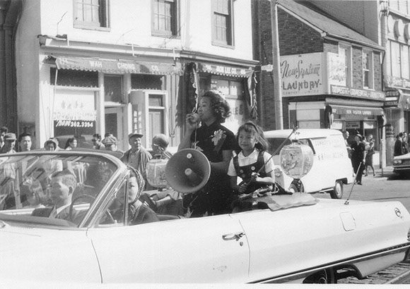 Jean Lumb was the co-owner of the famous Kwong Chow Restaurant in Chinatown for 23 years. Aside from being a successful restaurateur, she remained a prominent force in Toronto's Chinese community. She is seen here in a Save Chinatown rally during the 1960s.