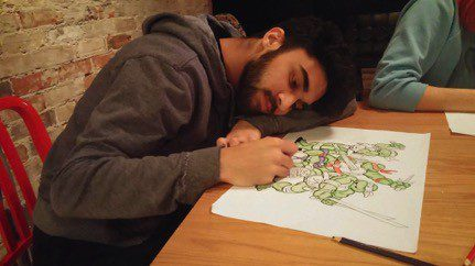 Kyle Burnett concentrates on staying within the lines at an adult colouring session held at Toronto's Gladstone Hotel.