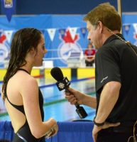 Canadian Paralympic star Aurélie Rivard is interviewed by Scott Russell of the CBC
