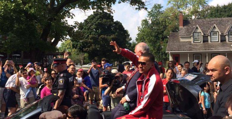 Markham crowds get a glimpse of local Rio 2016 hero Andre De Grasse during parade Sunday.