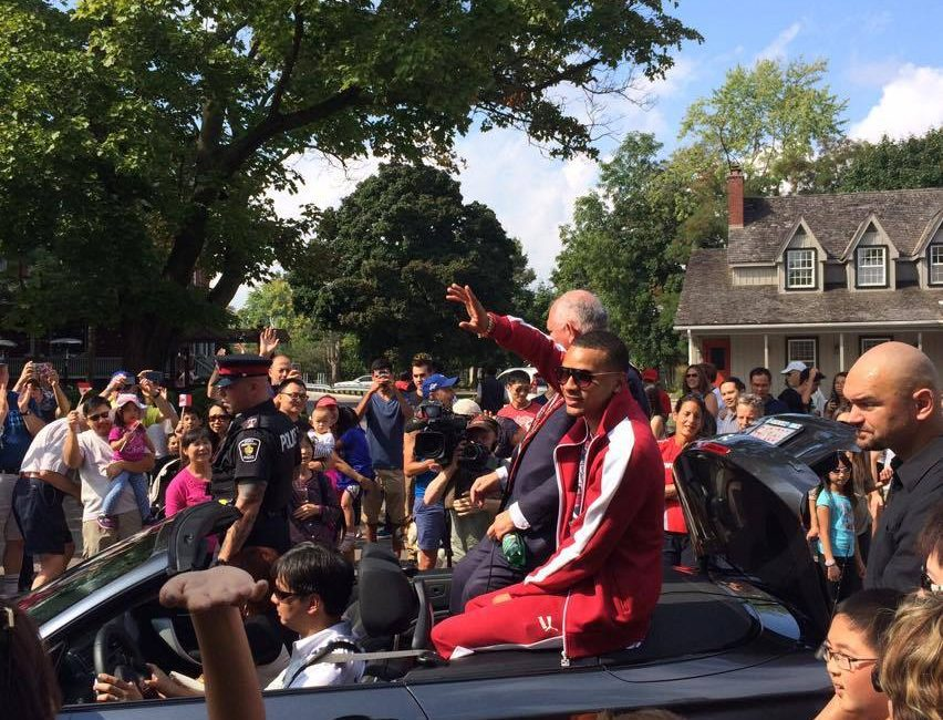 Markham crowds get a glimpse of local Rio 2016 hero Andre De Grasse during parade Sunday.