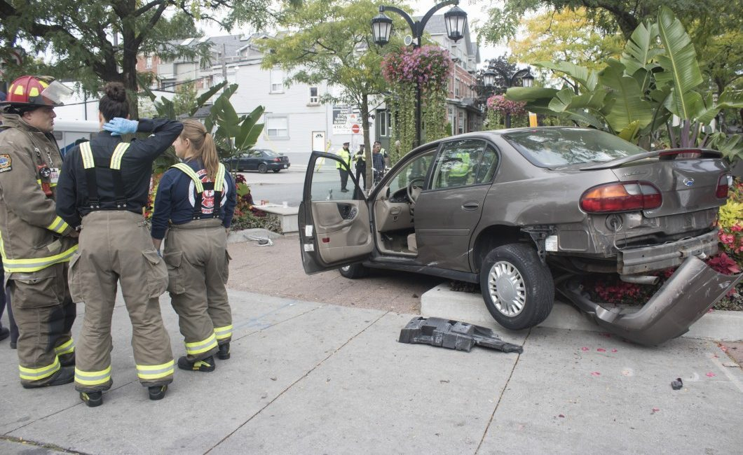 Vehicle that jumped the curb and hit three pedestrians sits in Alexander the Great Parkette.