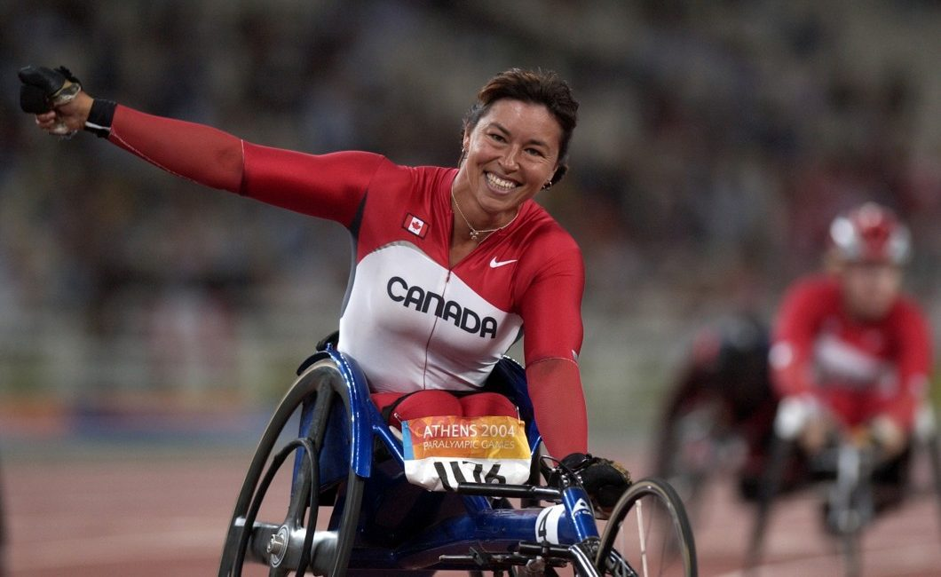 Chantal Petitclerc wins fifth gold medal in the 200 meters in Athens 2004.