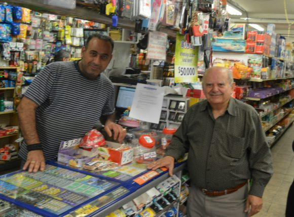 Emil Hihen (left) and Salim Higig (right) of Milk Mart Convenience, think the price increase will hurt seniors the most. (SCOTT DELL)