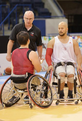 Coach Steve Bialowas speaks to Peter Won and David Eng (right) as Canada's Men Wheelchair Basketball team holds an open practice in the Mattamy Athletic Centre during the Toronto 2015 Parapan American Games .