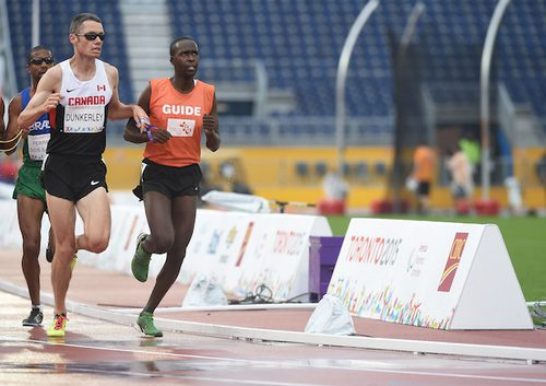 Jason Dunkerley and his guide Josh Karanja compete in the men's 5000m T11 during the Toronto 2015 Parapan Am Games