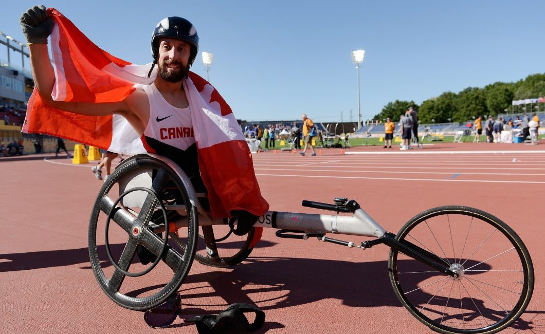 Flag-draped Brent Lakatos, after Parapan Am gold in Toronto, chases a bigger prize in Rio. Photo courtesy of Canadian Paralympic Committee.