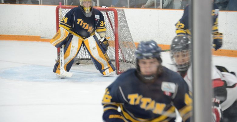 Toronto Titans forward Jacob King [foreground] chases the puck as goaltender Dylan Tower looks on at Westwood Arenas in Etobicoke, Ont. on October 29, 2016
