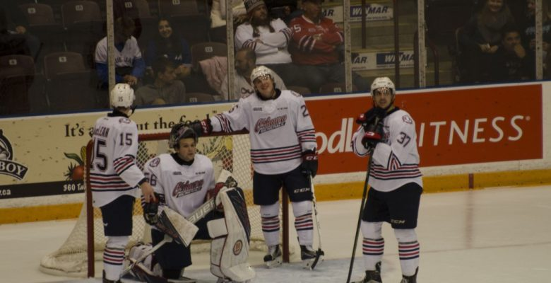 Kenny Huether (middle right) shared a laugh with his teammates as he goes on to score 2 goals against the Petes.