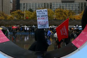 Protesters at the rally in the rain